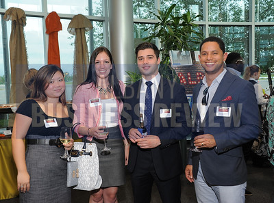 6-18-2015, Albany Business Review's Book of Lists bash. Tracey Agustin of 1st National Bank of Scotia, Jennifer Soccio of New York Life, Kevin Baker of Schwartz Heslin Group and Roman Jaquez of Compass Pictures.