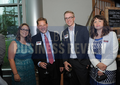 6-18-2015, Albany Business Review's Book of Lists bash. Courtney Myers from the Business Review with Jason Lurie of Wealth Advisory Group, Ryan Watroba of Coldwell Banker Prime Properties and Anne Morrill of Big Brothers BIg Sisters.
