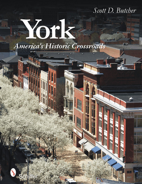 """York: America's Historic Crossroads<br /> York has been has been at the crossroads of American history for over 265 years. The first town west of the Susquehanna River, it was an early gateway for westward migration, played roles in both the American Revolution and Civil War, and contributed greatly to the Industrial Revolution. Take a tour of this historic town from humble eighteenth century buildings withstanding the test of time to the brand new office towers that herald a twenty-first century revitalization. The façades of York tell stories about early settlement, the fight for independence, economic prosperity, decline, and rebirth. The streets are an open-air gallery of architectural achievement, offering a diverse array of styles encompassing portions of four centuries. Beautiful photographs and stories showcase the charm and wonder of a small-town growing into a metropolis of historic relevance. <br /> <br /> Order: <a href=""""http://www.schifferbooks.com/newschiffer/book_template.php?isbn=9780764330124"""">http://www.schifferbooks.com/newschiffer/book_template.php?isbn=9780764330124</a>"""