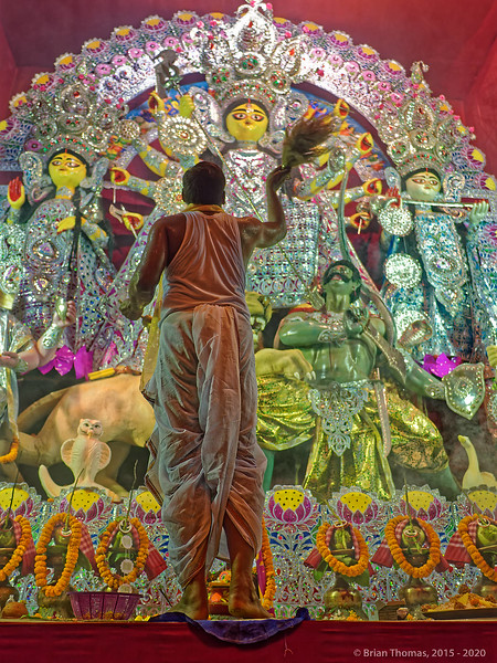 A priest performs an elaborate ritual to invite the goddess into a idol. With 2,000 pandals, Durga Puja is like a temporary full employment act for Calcutta's artists and priests.