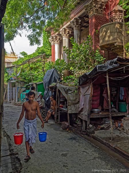 Potter carries water back to his Kurmatoli studio