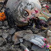 """""""In this new millennium Calcutta has responded to environmental concerns. Just after getting dunked in the river the now vacant idols are, as you can see above, quickly removed from the river so they can be buried in a landfill.""""<br /> <br /> This concludes the online appendix for 25¢ a Cup - finding Paris in India, my story of a year in Calcutta. If the reader is interested in a free online photo story about my hometown, Portland, Oregon, click the link below the next picture."""