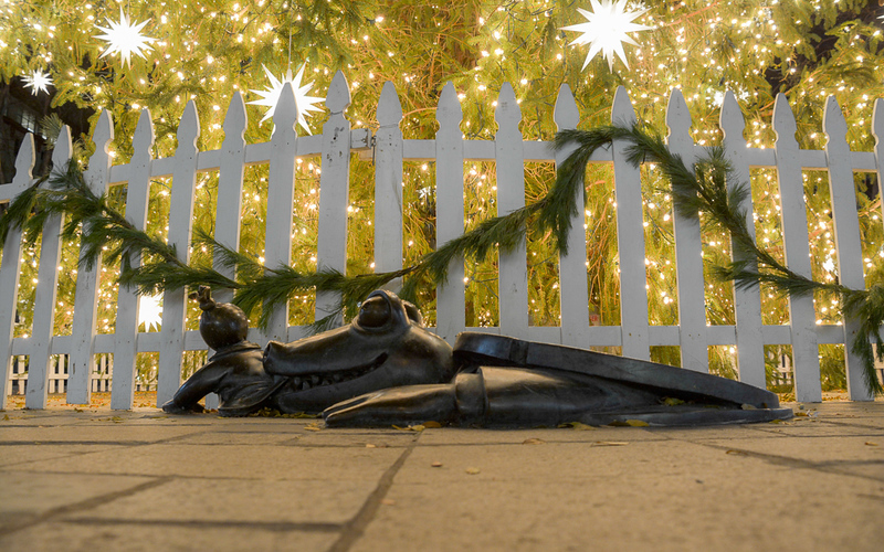 This street-art by Tom Otterness in Brooklyn, NY shows an alligator with human hands emerging from a manhole cover to devour a man in a suit with a moneybag for a head.  Elliott isn't fond of avenging alligators or evil capitalists but appreciates the message. The huge evergreen tree in the background was decorated for Christmas.