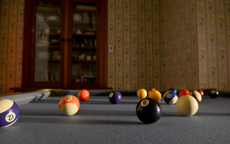 Time to play pool! Elliott and his friends like to roll the balls into the pockets before heading off to bed.