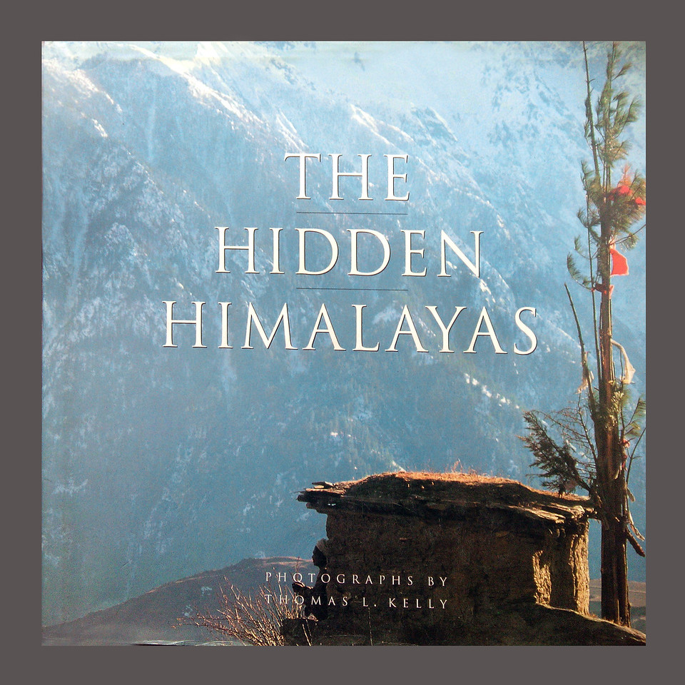 The Hidden Himalayas<br /> <br /> PHOTOGRAPHY BY THOMAS L. KELLY<br /> TEXT BY CARROLL DUNHAM,<br /> <br /> Thomas Kelly and Carroll Dunham, two young Americas, a photographer and a writer-anthropologist, take you the strangest place in the world. Beautiful, bitter, joyous, and holy, it is Humla, an ancient territory at the edge of Nepal. Bordering Tibet, hidden in the Himalayas<br /> <br /> The vistas captures in Kelly's photographs are both limitless and intimate, here is a land of eternally snow-capped mountains and sweeping valleys, eerie, forbidding as the landscape of some distant moon, its people all but forgotten by the rest of the world. Their lives are struggle—the alpine soil metes out sustenance grudgingly; trade with distant neighbors means days of driving stubborn yaks over perilous mountain trails; disease is a constant companion (the average woman bears eight children, of whom six may live to adulthood); and the long winter threatens to banish the warmth of life forever.<br />  <br /> Yet these lives yield untold riches. As if the splendid isolation and sheer altitude of the hidden Himalayas bring their inhabitants closer to the gods, the Hindu Chhetri and Thakuri and Buddhist Bhotia people of this land are possessed of spirituality few Westerners will ever know. In Humla, the gods are everywhere—in the clouds, in the mountains, in the very dung with which the soil is fertilized. Here is Lobsang Lama, who lives with wife, Eppi, in a rock-carved mountainside hermitage. His life of meditation and good works has been a preparation for the moment of death. Old, sick, he declares that he will die in five days and, on the fifth day, passes away in utter peace. And then there is Takha Bahadur, no less holy, but seeing herself slighted in worship, takes demonic possession of his wife. Indeed, a spiritual life of Humla is never entirely peaceful. Its many festivals of religious celebrations are marked by a joyous, raucous carnality: from the fantastic masked Mani carnival to the operatic wedding ceremony of the Bhotia, who practice a rare form of polyandrous marriage in which one wife is shared by any number of brothers.<br /> <br /> Kelly's extraordinary photographs are accompanied by Dunham's evocative and lyrical account of life through four seasons in Humla: Fall, winter, spring and summer. In a world made easy, accessible, and all too familiar by supersonic travel, television and communication, and intimate, moving adventure in one of the last truly exotic places on earth.<br /> <br /> This book is available at Thomas Kelly's office @ Kathmandu, Nepal, at USD 60<br /> Place your order at:<br /> tkelly@photo.wlink.com.np<br /> TeleFax# 977-01-443-8883,<br /> 	 # 977-01-4431-954<br /> Moblie # 977-98510-26738	<br /> P.O.B: 1406<br /> Kathmandu, Nepal.