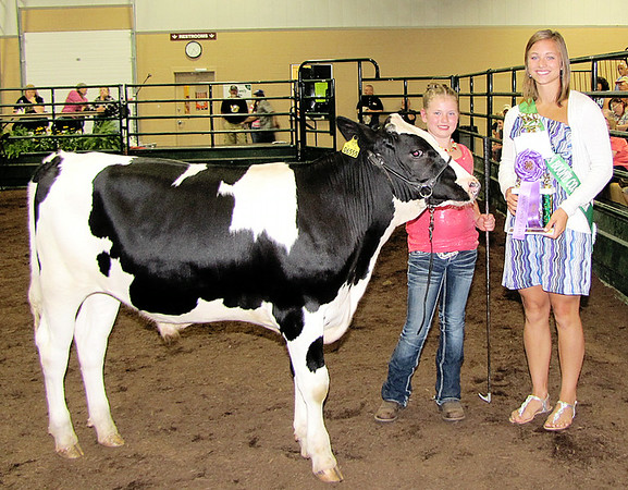 Rod Rose The Lebanon Reporter<br /> Kennedy Kiger was named gtrand champion of the Boone County 4-H Fair's starter calf show Saturday; presenting her the trophy and ribbon was Miss Congeniality Abby Messenger.