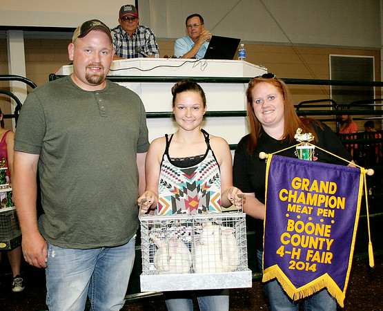 Rod Rose The Lebanon Reporter<br /> Daniel and Breanna Shively of Shively Cattle Co. bid $250 for Holly Foxworthy's grand champion rabbit meat pen at Thursday's Boone County 4-H Livestock Auction.