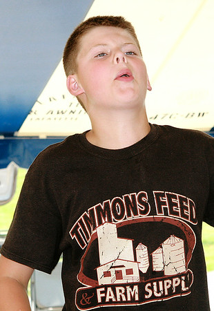 Rod Rose The Lebanon Reporter<br /> Matthew Keith, 12, launches a seed 17-feet 11-inches to win the 9-12 age division at the Boone County 4-H Fair's watermelon seed spitting contest Tuesday.