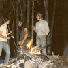 Bob clowns around and Steve looks on as we tend a sweatlodge fire on Harpers Creek in 1983.