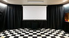 UPDATE 10/27/2012 - We used some black sheets to create curtains all the way around the perimeter of the theater.