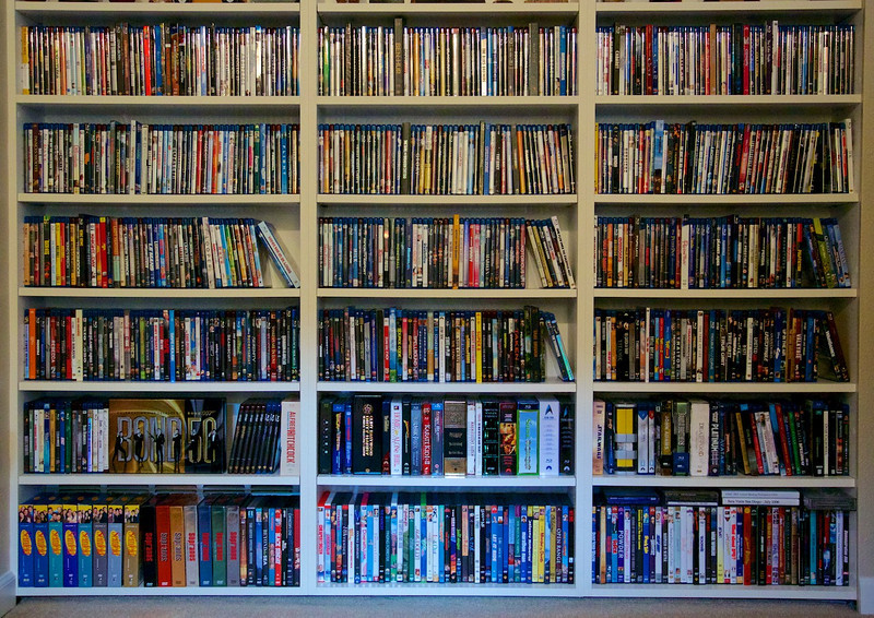 UPDATE 02/20/2013 - Our current media collection. The top four shelves (plus a little bit of the fifth shelf) are Blu-ray and HD DVD titles mixed together in alphabetical order.  The fifth shelf is Blu-ray and HD DVD sets plus some miscellaneous titles. The bottom shelf is all DVDs.