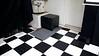 UPDATE 10/27/2012 - The Velodyne VA1012 subwoofer still resides in the corner.  It provides plenty of bass for the garage theater.