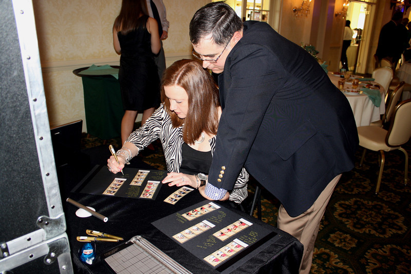Guests writing in memory book