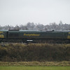 A distance shot across the fields of 66508 in Barrow Hill sidings awaiting a departure with a coal train