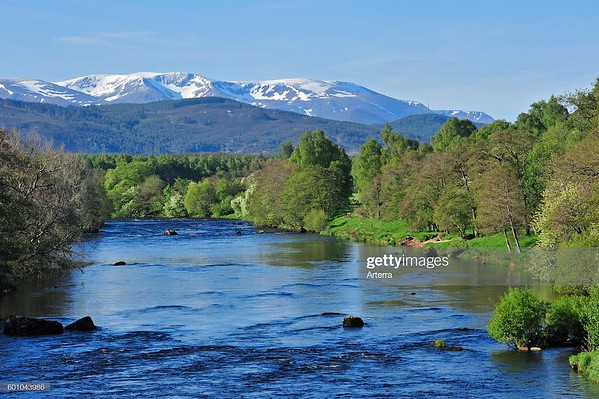 The River Spey near Aviemore and the Cairngorm mountains covered in snow, Badenoch and Strathspey, Highlands, Scotland, UK. (Photo by: Arterra/Universal Images Group via Getty Images)