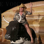 Heather Harris demonstrated her mechanical bull riding skills.