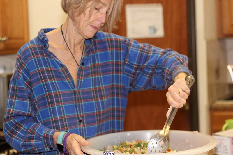 WELCA/Ammparo Border Immersion trip, February 1-5 2020, El Paso, Texas | <br /> <br /> <br /> Laurie Tanner stirs the pasta salad that will be served to the participants at the 11:00 worship service at Cristo Rey.