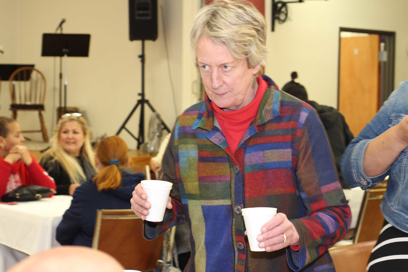 WELCA/Ammparo Border Immersion trip, February 1-5 2020, El Paso, Texas | <br /> <br /> <br /> Mary Meierotto serves a Mexican hot chocolate drink at the meal after the service.
