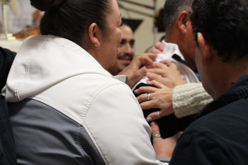 WELCA/Ammparo Border Immersion trip, February 1-5 2020, El Paso, Texas | <br /> <br /> <br /> Members lay hands on Pastor Juan de Dioz Lopez because it was the first day of his internship at Cristo Rey.