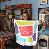 "WELCA/Ammparo Border Immersion trip, February 1-5 2020, El Paso, Texas | <br /> <br /> <br /> Estela Huerta on staff at the library, poses with the ""Just Love"" banner we gifted her."