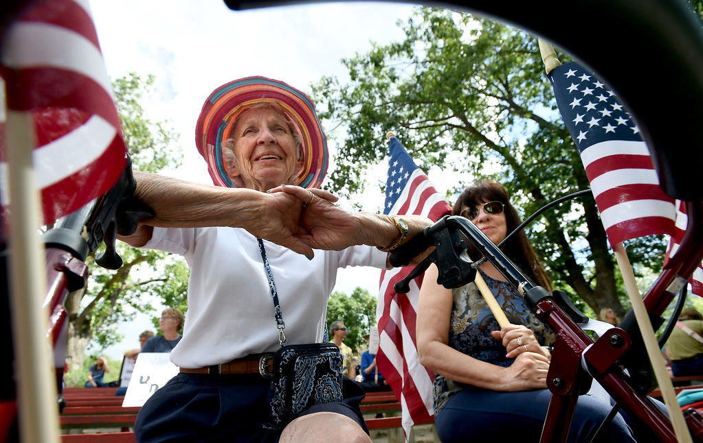 . Charleen Pappas, left, and her daughter, Andrea Pappas Merrill, were flying the USA colors during the rally. About  200 people protested in Central Park in Boulder on Friday about the Trump separation policy at the border with Mexico. For more photos, go to dailycamera.com. Cliff Grassmick  Staff Photographer  June 22, 2018