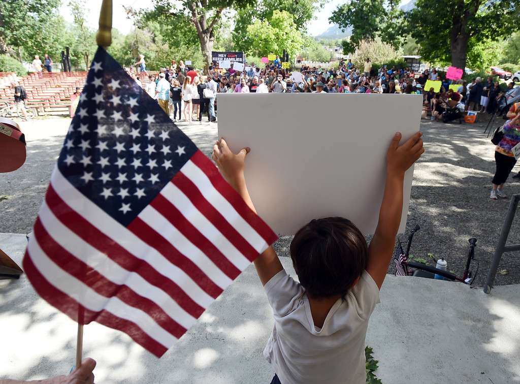 . Jacobo Cordero, 4, holds up his protest sign on stage during the rally. About  200 people protested in Central Park in Boulder on Friday about the Trump separation policy at the border with Mexico. For more photos, go to dailycamera.com. Cliff Grassmick  Staff Photographer  June 22, 2018