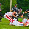 Groton-Dunstable's Logan Higgins is wrapped up by North Middlesex's Alex Hollenback and Cameron Meservey . Nashoba Valley Voice/Ed Niser