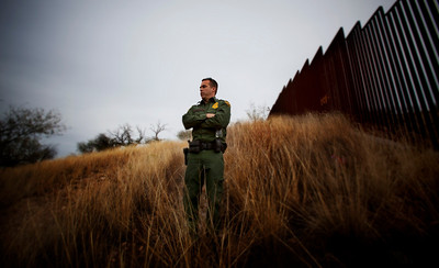 US Border Patrol agent watches the hillsides near Nogales. ©Bob Torrez