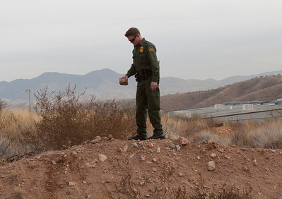 US Border Patrol agent shows rocks similar to the ones thrown at agents and vehicles.©Bob Torrez