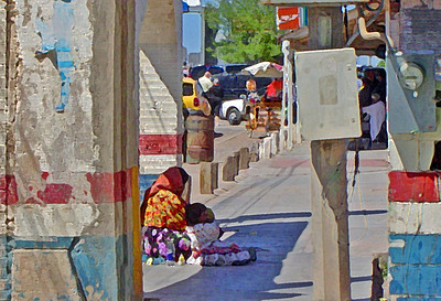 Beggar woman and her child in Puerto Palomas, Mexico.