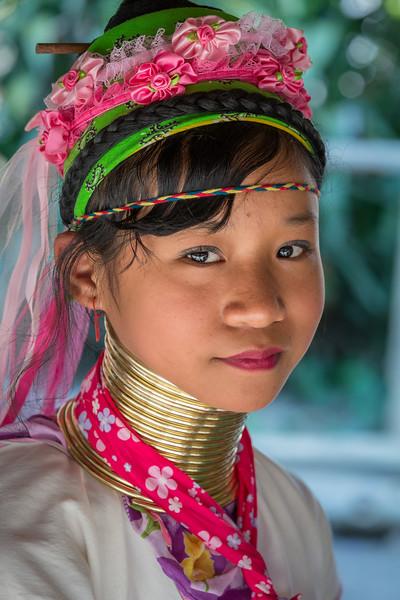 Ban Mae Khao Tom, Chiang Rai Province, Thailand. A Padaung Karen girl.