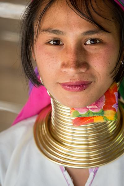 Ban Mae Khao Tom, Chiang Rai Province, Thailand. A young Padaung Karen woman.