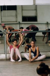 PUERTO RICO. San Juan. 1973. Young ballet dancers rest between practice sessions at the San Juan Ballet School.