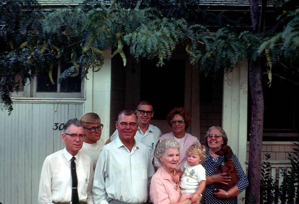 From left to right: uncle Charles Boshell (dad's brother), Jim, my dad, me, my grandma Boshell holding Sherrie, Mom, and Aunt Dorothy (Uncle Charles first wife). Oh yes, Susie, our weeny hound.