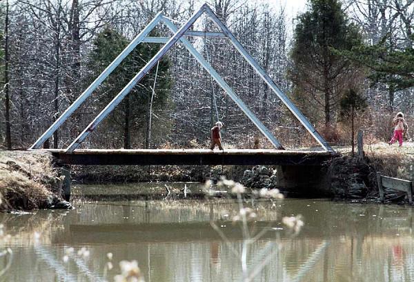 David crossing the bridge on Chance lake at Sunnydale Academy.