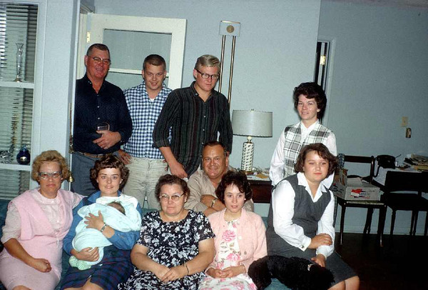 At the Ed Wagner residence, Boulder, CO, probably about 1967?. Mom, Dad, Karen holding Jeff, Bruce Wager, Erna Wagner, Jim, Ed Wagner, Jim's girlfriend, Marion, and Gail Wagner.