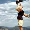 David feeding bird on edge of Trail Ridge Road in Rocky Mountain National Park.
