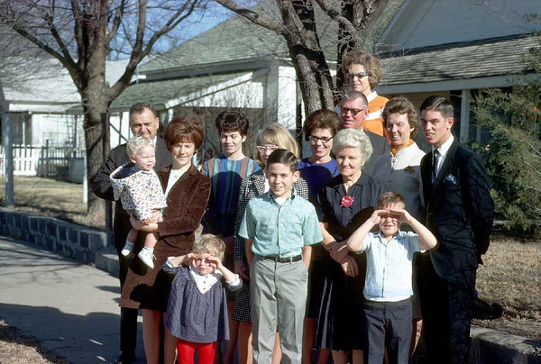 L to R: David, Uncle Ernie Kalapathy, Donna Pickens (holding David), Sherrie, Marion, Marilyn Kalapathy, Aunt Phyllis Pickens, Grandma Boshell, Dad, Mom, Aunt Fern Kalapathy, Glenn Pickens, Paul Pickens (right front row).
