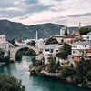 View on the city of Mostar with the Stari Most old bridge and the Neretva river surrounded by mountains in Bosnia and Herzegovina.