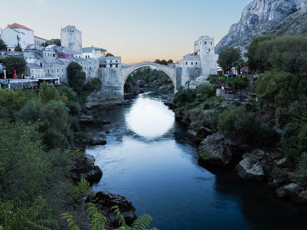 Early morning at the Old Bridge in Mostar.  A Unesco world heritage site, the original bridge was built around 1567.  It was intentionally destroyed in '93, more to erase a cultural symbol than for strategic advantage.  After the war, it was rebuilt like the original.