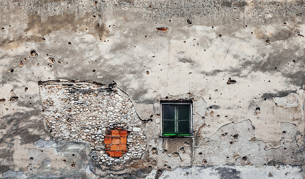 Bullet holes from the Bosnian War in a building in the city of Mostar