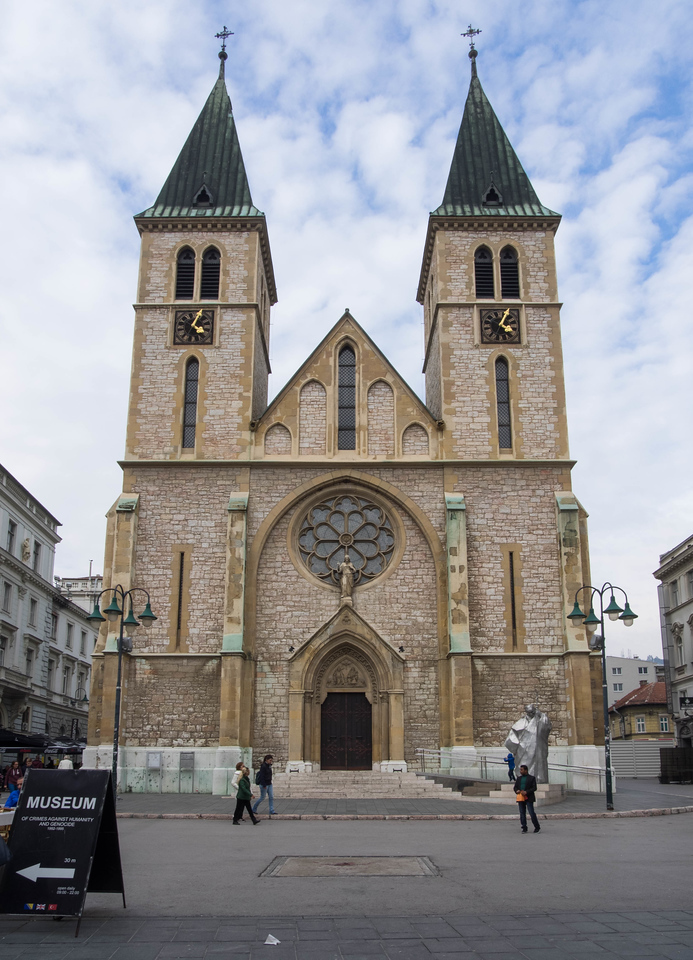 After Muslims, Catholics are the largest religious group in Sarajevo.  The Catholic Cathedral was gorgeous, but no photography was allowed inside.  The pock marks on the white foundation are from mortar shells.  Note the Sarajevo Rose right in front of it.