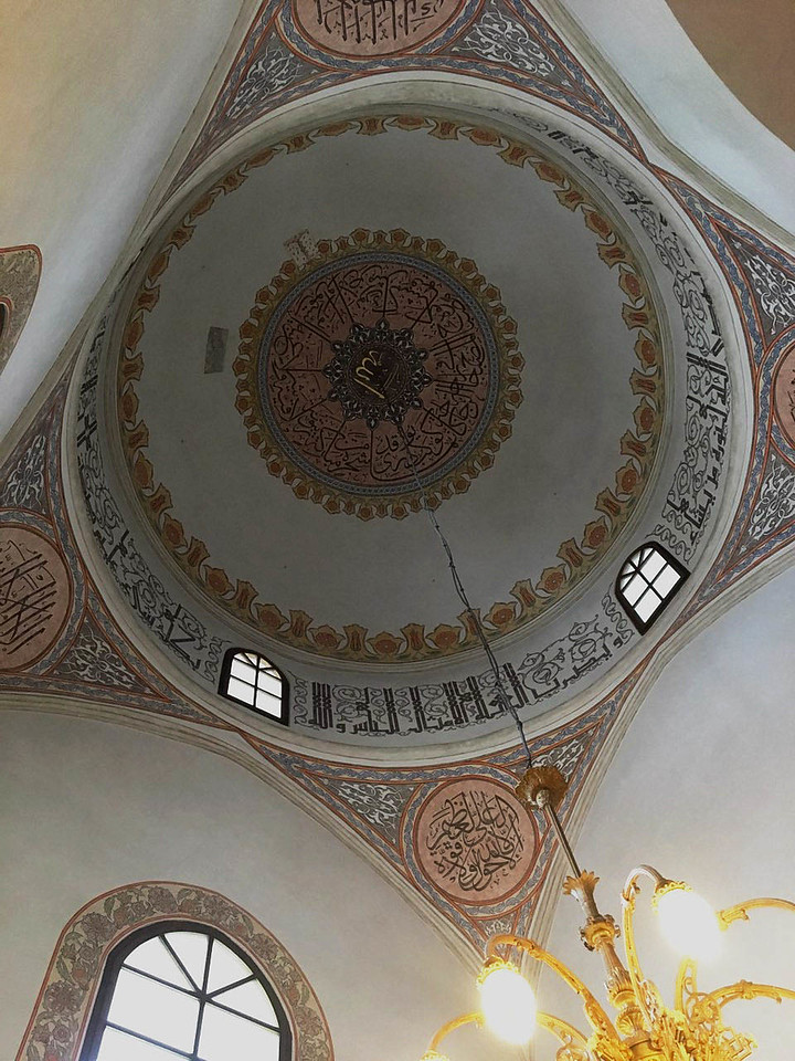 The interior of the central mosque in Sarajevo.  Built in 1530, it's named after Gazi Husrev-beg, a major contributor to the development of Sarajevo.  In 1898, it become the first mosque in the world to be lit with electric lights.<br /> <br /> Gazi Husrev-beg's 16th century endowment also built primary and secondary schools, a marketplace and bath place for residents, and lodging for traders and camels from the east.  <br /> <br /> Amazingly, the buildings noted above are still being used downtown today.