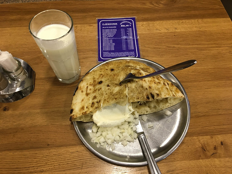 Dinner, a glass of yogurt (yummy and slightly tart) and cevapcici (minced meat sausage, some kind of creamy cheese, onions, and a pita like shell).  The lot set me back about $4.75.