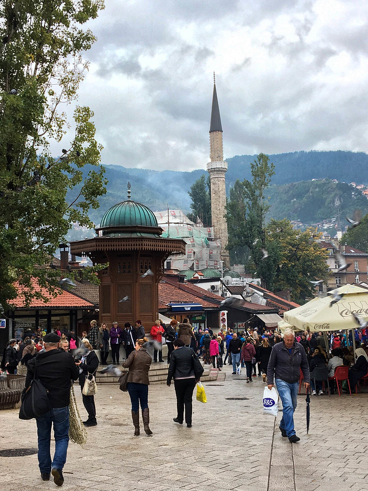 Barcarsija - the main square in Old Town Sarajevo.  The brown structure is a water fountain.  Rebuilt over the years, the original structure was built in 1753.  Legend has it that if you drink the water, you will return to Sarajevo.  Of course I drank.