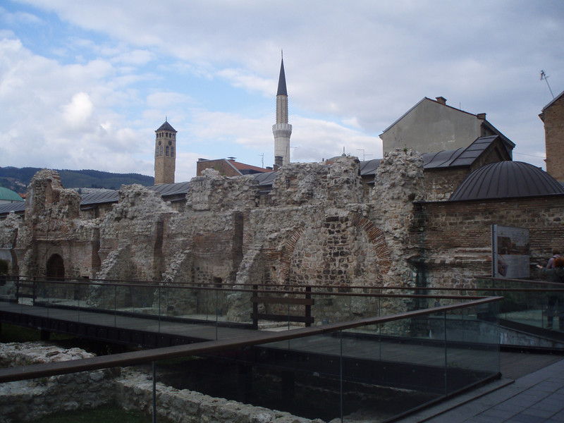 Ruins in Sarajevo, with a mosque in the background.