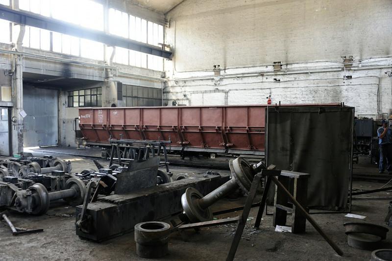 Wagons, Banovici railway works, Bosnia-Hercegovina, Wed 11 June 2014 1.  Here are three views of wagons under repair.