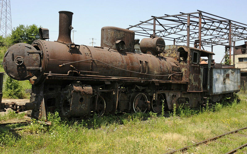 83-157, Banovici railway works, Bosnia-Hercegovina, Wed 11 June 2014.  Banovici has four of the classic Yugoslav 76cm gauge 0-8-2, of which 187 were built between 1903 and 1949.  Only 83-159, seen later, was operational at the time of my visit.  All four were built in Slavonski Brod, Croatia, by Djuro Djakovic in 1948-1949.  83-157 is 52 / 1948.
