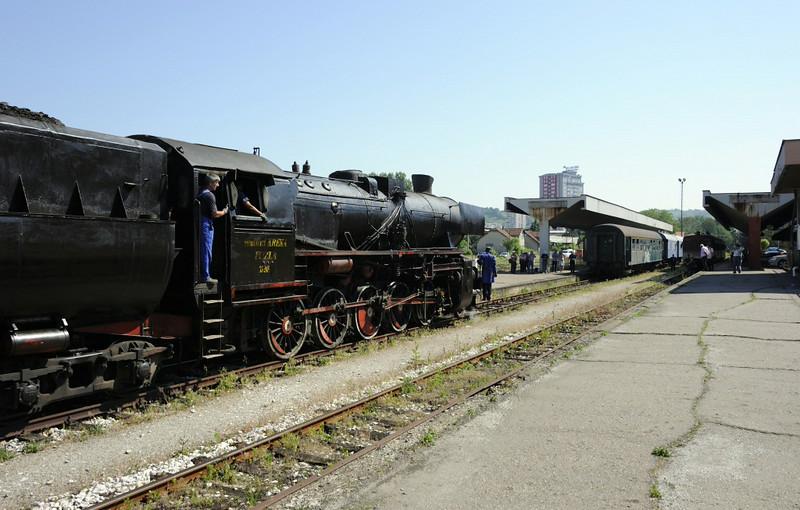 33-248, Tuzla station, Bosnia-Hercegovina, Tues 10 June 2014 - 0943.  The Kreka mines Kriegslok arrives to work our charter coach tender first north to Srebrenik.
