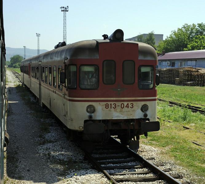 Srpska Republic Rlys (ZRS) 813-043 & 814-043, Kreka, Bosnia-Hercegovina, Tues 10 June 2014 - 1024.  The 1020 Tuzla - Doboj passes our charter outside Tuzla.